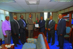 Congratulations ! PS, MEMR, Mr. Ali Mohamed congratulates  Mr. Mduduzi Shabane from South Africa who is the current Chair  of the RCM on being presented with the title deed for  the ten acres of land. 2