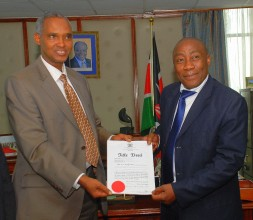Congratulations ! PS, MEMR, Mr. Ali Mohamed congratulates  Mr. Mduduzi Shabane from South Africa who is the current Chair  of the RCM on being presented with the title deed for  the ten acres of land. 3