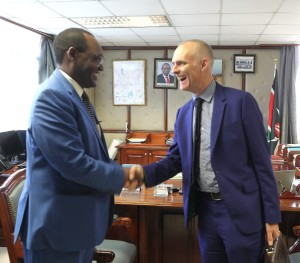 Environment and Forestry PS Dr. Chris Kiptoo exchange pleasantries as he receives EU Ambassador Simon Mordue , when he paid him a courtesy call.