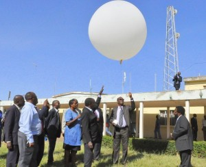 PS, Dr. Chris Kipsang, launching the weather forecasting baloon during the familiarization tour to KMD
