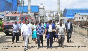 PS, Dr. Chris Kiptoo( glasses) with the chair of Water Resources Mngment Authority, Hon. Joe Mutambo, Nyanza Regional Commissioner, James Kianda,(kaunda suit) and other officials touring Kibos sugar factory