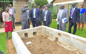09.03.2020:- The PS, Dr. Kiptoo, viewing the drying of seeds at KEFRI. He challenged the research  Institute to adopt modern technology of drying the seeds.