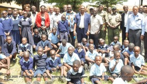 PS, Dr. Chris Kiptoo with other multi-agency officials join pupils of Kibos special school and their teachers in a group photo.