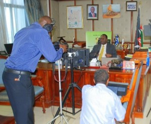 PS Dr Chris Kiptoo at his office during the recording of the World Meteorological Day message with Kenya Meteorological technical staff.