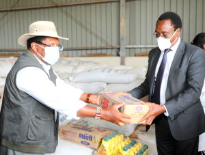 CS tobiko hands over boxes of bar soap and cooking oil to Kajiado North MP Joseph Manje