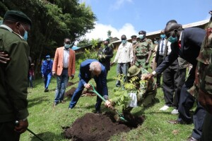 Europe Union Envoy  Simon Mordue plants a commemorative tree at Moron Pri. School, Marakwet East Constituency, in Embobut forest.