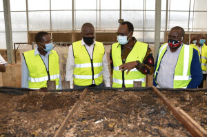 PS Dr Chris Kiptoo second right , Sanergy Managing Director Michael Lwoyelo left and Deputy Chief of Staff- Presidency Dr. Francis Muray (second right), during the tour at Sanergy recycling plant.