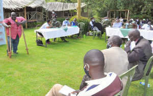 A member of the Kaptagat CFAs gives views during the meeting, The PS advised the CFA members that they Must Support Government conservation efforts in order for them to benefit from the forests.