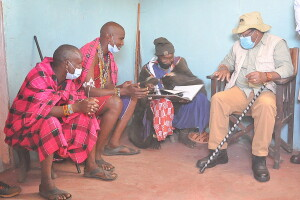 CS, Mr. Keriako Tobiko, holding talks with the Maasai Laibon, who is involved int the protection and conservtion of the Loita forest.