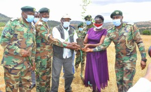 CS, Mr. Keriako Tobiko, with Laikipia North MP, Hon. Sarah Korere and senior Kenya Forest Officials, preparing to plant a commemorative tree at Orjijo Pri. Sch, Laikipia North.