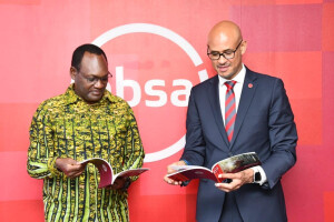 Environment PS Dr Chris Kiptoo and ABSA Kenya Managing Director Jeremy Awouri take a look at the 2020 ABSA bank sustainability report, the bank has committed to plant  10 million seedlings in the next 5 years.