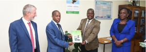 n connection to the Webinar Augustine Kenduiwo, MEF, hands over a copy of the Kenya Green Economy Strategy and Implementation Plan to Prof. Nura Mohammed, KSG. From left to right: