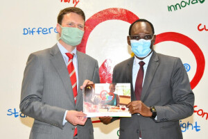 PS Dr. Chris Kiptoo and Bio Food limited Managing Director Eelco Weber when presided over the launch of sustainability report for Bio Food Products limited.