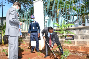 PS Dr. Chris Kiptoo plants a tree after the launch of Bio Foods sustainability report the PS challenged manufacturers to embrace sustainable waste management and circular economy as part of their contribution to clean and healthy environment.