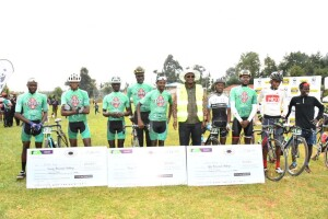 Environment PS Dr. Chris Kiptoo in a reflector jacket, in a group photo with winners who participated in the cycling race at Kaptagat Forest to raise awareness on the need for non motorised transport as a way of cutting carbon emissions.