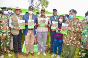 Environment PS Dr. Chris Kiptoo , (in the middle), Deputy CCF Patrick Kariuki-left, PS Harry Kimutai 2nd left, WWF-Kenya CEO Mohamed Awer, NEMA Chair John Konchela and Elgeyo Marakwet County Commisoner Dr. Ahmed Omar hold copies of the launched master plan.