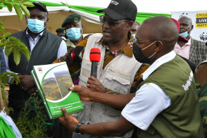 PS Kiptoo and WWF Ag. Head of Conservation Jackson Kiplagat (right) hold copies of the master plan, Dr. Kiptoo said the proposed interventions will help curb environmental challenges in the Cherangany- Elgeyo Hills Ecosytem.